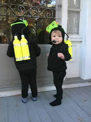 Christine Rose made scuba diver costumes for her sons, John and James. The costumes cost almost nothing.